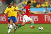 Gilberto Silva of Brazil challenges Danny of Portugal during the 2010 FIFA World Cup South Africa Group G match between Portugal and Brazil at Durban Stadium on June 25, 2010 in Durban, South Africa.