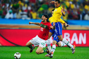Danny of Portugal falls under the challenge of Gilberto Silva of Brazil during the 2010 FIFA World Cup South Africa Group G match between Portugal and Brazil at Durban Stadium on June 25, 2010 in Durban, South Africa.