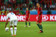 Cristiano Ronaldo (R) of Portugal reacts during the UEFA EURO 2016 Group F match between Portugal and Iceland at Stade Geoffroy-Guichard on June 14, 2016 in Saint-Etienne, France.