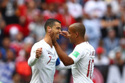 Cristiano Ronaldo of Portugal celebrates with team mate Joao Mario  after scoring his team's first goal during the 2018 FIFA World Cup Russia group B match between Portugal and Morocco at Luzhniki Stadium on June 20, 2018 in Moscow, Russia.