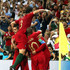 Cristiano Ronaldo Joao Mario Photos - Cristiano Ronaldo of Portugal celebrates with teammates after scoring his team's third goal during the 2018 FIFA World Cup Russia group B match between Portugal and Spain at Fisht Stadium on June 15, 2018 in Sochi, Russia. - Portugal Vs. Spain: Group B - 2018 FIFA World Cup Russia