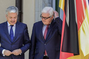 Belgium's Foreign minister Didier Reynders (L) and Germany's Foreign minister Frank-Walter Steinmeier  arrive for a group photo at the villa Borsig prior to post-Brexit talks in Berlin on June 25, 2016..Foreign ministers of the six founding members of the European project meet to discuss the bloc's future in the wake of Britain's decision to leave. . / AFP / John MACDOUGALL