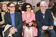 Hamish Bowles, Bianca Jagger (in Prada) and Tim Blanks while attending the Prada Resort 2018 Womenswear Show in Osservatorio on May 7, 2017 in Milan, Italy.