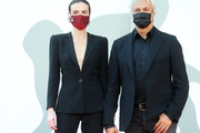 "Kasia Smutniak and Domenico Procacci walk the red carpet ahead of the movie ""I Predatori"" at the 77th Venice Film Festival on September 11, 2020 in Venice, Italy."
