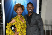 "Ryan Michelle Bathe and Sterling K. Brown attends the premiere of 20th Century Fox's ""Breakthrough"" at Westwood Regency Theater on April 11, 2019 in Los Angeles, California."
