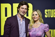 """Mira Sorvino (R) and Christopher Backus attend the premiere of 20th Century Fox's """"Stuber"""" at Regal Cinemas L.A. Live on July 10, 2019 in Los Angeles, California."""