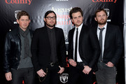 (L-R) Matthew Followill, Nathan Folllowill, Jared Followill and Caleb Followill of Kings of Leon attend the premiere of 'August: Osage County' presented by The Weinstein Company with Ram Trucks on December 12, 2013 in New York City.
