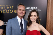 "Roy Price, Head of Amazon Studios (L) and actress Lily Collins arrive at the premiere of Amazon Studios' ""The Last Tycoon"" at the Harmony Theatre on July 27, 2017 in Los Angeles, California."