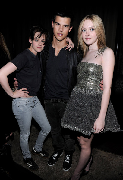 Actress Kristen Stewart, actor Taylor Lautner and actress Dakota Fanning attend the after party for the premiere of Apparition's 'The Runaways' held at ArcLight Cinemas Cinerama Dome on March 11, 2010 in Los Angeles, California.