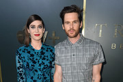 Lizzy Caplan and Tom Riley arrive at the premiere of Apple TV+'s 'Truth Be Told' at AMPAS Samuel Goldwyn Theater on November 11, 2019 in Beverly Hills, California.
