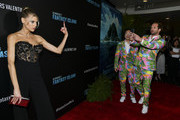 """(L-R) Charlotte McKinney, Jimmy O. Yang, and Ryan Hansen attend the premiere of Columbia Pictures' """"Blumhouse's Fantasy Island"""" at AMC Century City 15 on February 11, 2020 in Century City, California."""