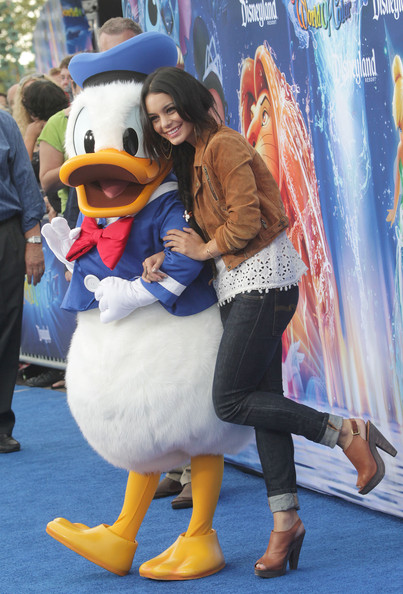 """Actress Vanessa Hudgens (R) and Disney character Donald Duck attend the premiere of Disney California Adventure Park's """"World of Color"""" Spectacular on June 10, 2010 in Anaheim, California."""