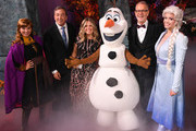 """(L-R) Peter Del Vecho,  Jennifer Lee, Chief creative officer of Walt Disney Animation Studios and Chris Buck with Frozen characters attend the premiere of Disney's """"Frozen 2"""" at Dolby Theatre on November 07, 2019 in Hollywood, California."""