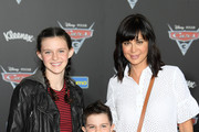 """Actor Catherine Bell (R) attends the premiere of Disney and Pixar's """"Cars 3"""" at Anaheim Convention Center on June 10, 2017 in Anaheim, California."""