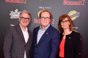 "John Walker, Brad Bird and Nicole Paradis Grindle attend the premiere of Disney and Pixar's ""Incredibles 2"" at the El Capitan Theatre on June 5, 2018 in Los Angeles, California."
