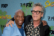 """John Singleton (L) and actor Alon Moni Aboutboul arrive at the premiere of FX's """"Snowfall"""" Season 2 at the Regal Cinemas L.A. LIVE Stadium 14 on July 16, 2018 in Los Angeles, California."""