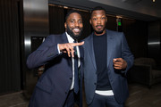 John David Washington (L) and Corey Hawkins attend the after party for the premiere of Focus Features' 'BlaKkKlansman' at Samuel Goldwyn Theater on August 8, 2018 in Beverly Hills, California.