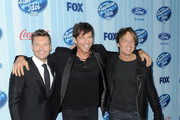 (L-R) Host Ryan Seacrest, musicians Harry Connick Jr. and Keith Urban arrive at the premiere of Fox's 'American Idol Xlll' at UCLA's Royce Hall on January 14, 2014 in Los Angeles, California.
