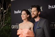 "Lizzy Caplan and Tom Riley arrive at the premiere of Hulu's ""Castle Rock"" season 2 at AMC Sunset 5 on October 14, 2019 in Los Angeles, California."