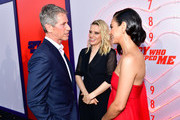 (L-R) CEO of Lionsgate Jon Feltheimer, Kate McKinnon, and Mila Kunis attend the premiere of Lionsgate's 'The Spy Who Dumped Me' at Fox Village Theater on July 25, 2018 in Los Angeles, California.