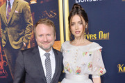 Rian Johnson and Ana de Armas Photos Photo