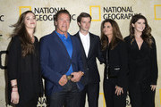 (L-R) Christina Schwarzenegger, Arnold Schwarzenegger, Patrick Schwarzenegger, Maria Shriver and Katherine Schwarzenegger attend the Red Carpet Event For National Geographic 'The Long Road Home' Premiere, on October 30, 2017, in Los Angeles, California. / AFP PHOTO / VALERIE MACON