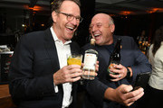 """Bryan Cranston (L) and Dean Norris pose at the after party for the premiere of Netfflix's """"El Camino: A Breaking Bad Movie"""" at Baltaire on October 07, 2019 in Los Angeles, California."""