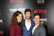 """(L-R)  Blake Anderson, Anders Holm and Adam DeVine attend the premiere of the Netflix film """"Game Over, Man!"""" at the Regency Village Westwood in Los Angeles at Regency Village Theatre on March 21, 2018 in Westwood, California."""