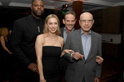 """(L-R) Winston Duke, Iliza Shlesinger, Peter Berg and Alan Arkin pose at the after party for Netflix's """"Spenser Confidential"""" at Baltaire on February 27, 2020 in Westwood, California."""