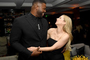 """Winston Duke (L) and Iliza Shlesinger pose at the after party for Netflix's """"Spenser Confidential"""" at Baltaire on February 27, 2020 in Westwood, California."""