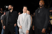 """(L-R) Kip Weeks, Mark Wahlberg, and Winston Duke attend the Premiere of Netflix's """"Spenser Confidential"""" at Regency Village Theatre on February 27, 2020 in Westwood, California."""