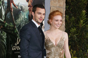"""Actor Nicholas Hoult (L) and actress Eleanor Tomlinson attend the Premiere Of New Line Cinema's """"Jack The Giant Slayer"""" at the TCL Chinese Theatre on February 26, 2013 in Hollywood, California."""