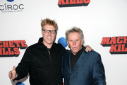 Actors Jake Busey and Gary Busey arrive at the premiere of Open Road Films' 'Machete Kills' at Regal Cinemas L.A. Live on October 2, 2013 in Los Angeles, California.