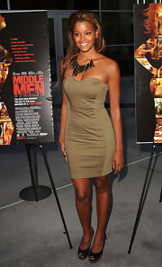 Claudia wore a military green, strapless cocktail dress. The paneled detailing flattered her figure and enhanced her curves.