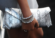 Claudia paired her beaded bracelets with a snakeskin printed clutch.