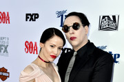 """Actor/singer Marilyn Manson (R) and Lindsay Usich arrive at the season 7 premiere screening of FX's """"Sons of Anarchy"""" at the Chinese Theatre on September 6, 2014 in Los Angeles, California."""