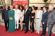 """(L-R)  Producer Lorenzo di Bonaventura, actors Helen Mirren, Bruce Willis, Mary-Louise Parker, director Dean Parisot, actors Catherine Zeta-Jones, John Malkovich, Byung-hun Lee and Neal McDonough attend the premiere of Summit Entertainment's """"RED 2"""" at Westwood Village on July 11, 2013 in Los Angeles, California."""