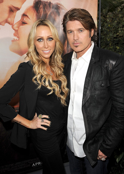 "Billy Ray Cyrus Executive producer Tish Cyrus (L) and actor Billy Ray Cyrus arrive at the premiere of Touchstone Picture's ""The Last Song"" held at ArcLight Hollywood on March 25, 2010 in Los Angeles, California."