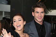 Actress/singer Miley Cyrus and actor Liam Hemsworth arrive at the