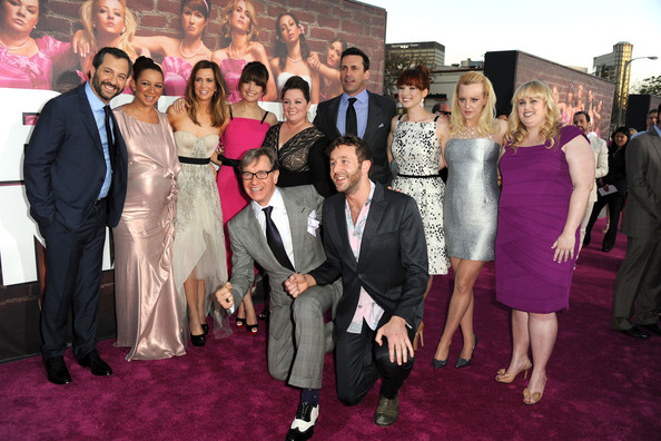 "(L-R) Producer Judd Apatow, actors Maya Rudolph, Kristen Wiig, Rose Byrne, Melissa McCarthy, Jon Hamm, Ellie Kemper, Wendi McLendon-Covey, Rebel Wilson, (front) director/executive producer Paul Feig and actor Chris O'Dowd attend the Premiere Of Universal Pictures' ""Bridesmaids"" at Mann Village Theatre on April 28, 2011 in Westwood, California."