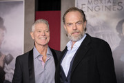 """Hugo Weaving and Stephen Lang. arrive at the premiere Of Universal Pictures' """"Mortal Engines"""" at Regency Village Theatre on December 5, 2018 in Westwood, California."""