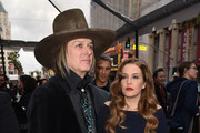 """Musician Michael Lockwood (L) and Lisa Marie Presley attend the premiere of Warner Bros. Pictures' """"Mad Max: Fury Road"""" at TCL Chinese Theatre on May 7, 2015 in Hollywood, California."""