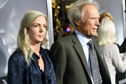 """Christina Sandera (L) and Clint Eastwood arrive at the premiere of Warner Bros. Pictures' """"The Mule"""" at the Village Theatre on December 10, 2018 in Los Angeles, California."""