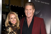 """David Hasselhoff (R) and Hayley Roberts arrive at the premiere of Warner Bros. Pictures' """"The Mule"""" at the Village Theatre on December 10, 2018 in Los Angeles, California."""