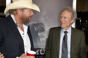 """Toby Keith (L) and Clint Eastwood arrive at the premiere of Warner Bros. Pictures' """"The Mule"""" at the Village Theatre on December 10, 2018 in Los Angeles, California."""