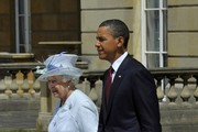 US President Barack Obama walks with Queen Elizabeth II during a ceremonial welcome in the garden of Buckingham Palace on May 24, 2011 in London, England. The 44th President of the United States, Barack Obama, and his wife Michelle are in the UK for a two day State Visit at the invitation of HM Queen Elizabeth II. During the trip they will attend a state banquet at Buckingham Palace and the President will address both houses of parliament at Westminster Hall.
