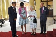 (L-R) First Lady Michelle Obama, US President Barack Obama, Queen Elizabeth II and Prince Philip, Duke of Edinburgh pose for a photo as they arrive to Buckingham Palace on May 24, 2011 in London, England. The 44th President of the United States, Barack Obama, and his wife Michelle are in the UK for a two day State Visit at the invitation of HM Queen Elizabeth II. During the trip they will attend a state banquet at Buckingham Palace and the President will address both houses of parliament at Westminster Hall.
