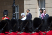 (L-R) Queen Elizabeth II, US President Barack Obama, First Lady Michelle Obama and Prince Philip, Duke of Edinburgh review an honour guard of the First Battalion Scots Guards at Buckingham Palace on May 24, 2011 in London, England. The 44th President of the United States, Barack Obama, and his wife Michelle are in the UK for a two day State Visit at the invitation of HM Queen Elizabeth II. During the trip they will attend a state banquet at Buckingham Palace and the President will address both houses of parliament at Westminster Hall.