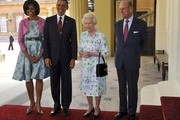 (L) First Lady Michelle Obama, US President Barack Obama, Queen Elizabeth II and Prince Philip, Duke of Edinburgh pose for a photo as they arrive to Buckingham Palace on May 24, 2011 in London, England. The 44th President of the United States, Barack Obama, and his wife Michelle are in the UK for a two day State Visit at the invitation of HM Queen Elizabeth II. During the trip they will attend a state banquet at Buckingham Palace and the President will address both houses of parliament at Westminster Hall.