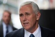 Vice President-elect Mike Pence takes to reporters as he arrives at Trump Tower on December 5, 2016 in New York City. Pence stopped briefly to comment to reporters on the nomination of of Ben Carson as housing secretary.